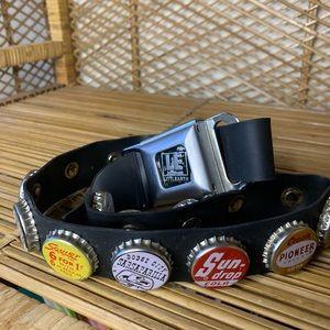 Little Earth seatbelt and soda top belt